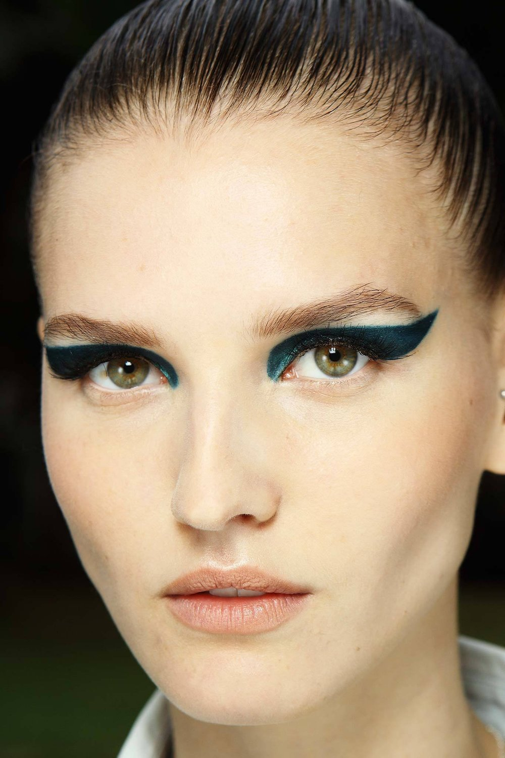 BRIGHT & BOLD Dramatic wings done in a rich jewel tone are worthy of Versace Couture—and a big night out. Stencil the shape with a teal pencil first, then apply a shimmery peacock-blue shadow from inner corner to end point. To set, dust a shimmery turquoise powder over top.