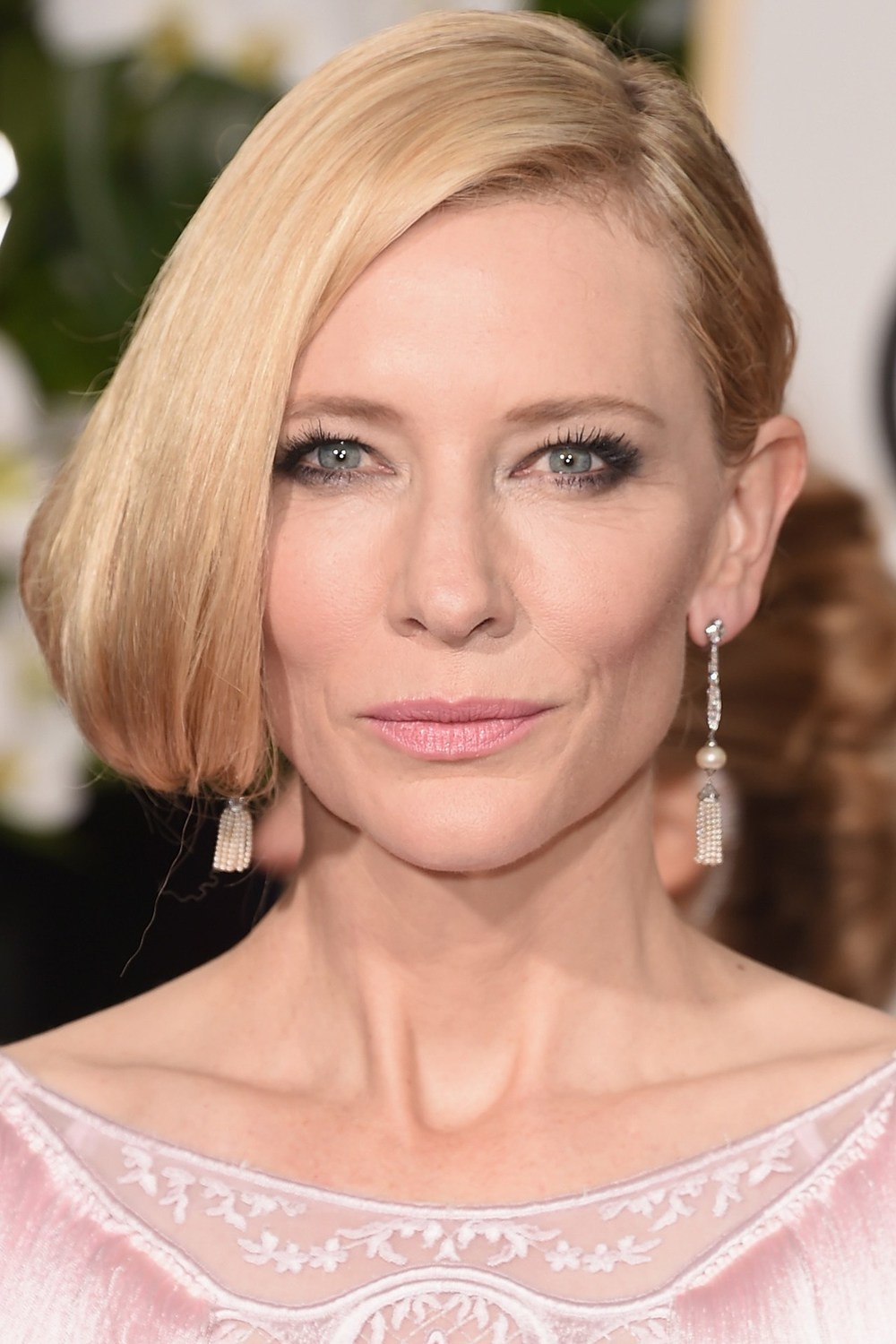 Cate Blanchett wore her hair parted low on one side, whilst her make-up look comprised pale pink lips, softly smoky eyes and illuminated skin.