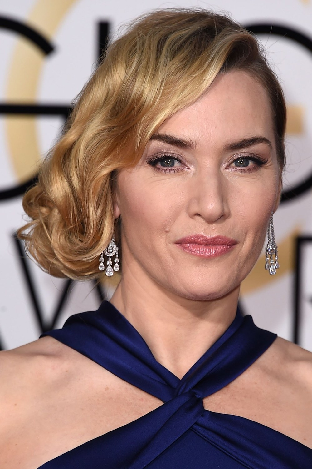 Kate Winslet, who won the best Supporting Actress award, was ANOTHER star who opted for a faux-bob hairstyle, offset by metallic eye make-up.