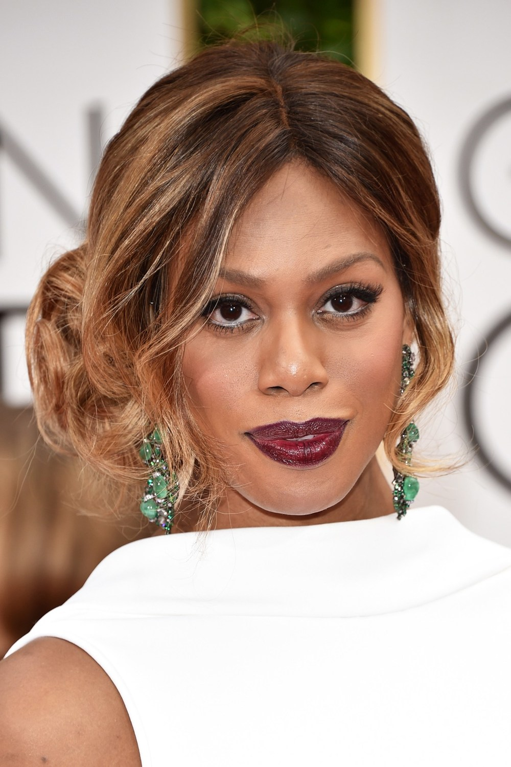 Laverne Cox wore her hair in a curled up-do, whilst bold plum lips were the focus of her make-up.