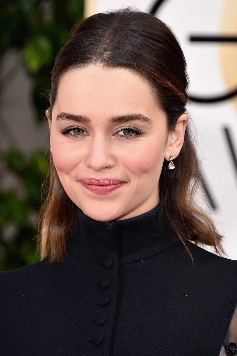 Rose-toned make-up and a half-up-half-down hairstyle lent Emilia Clarke a sophisticated, polished beauty.