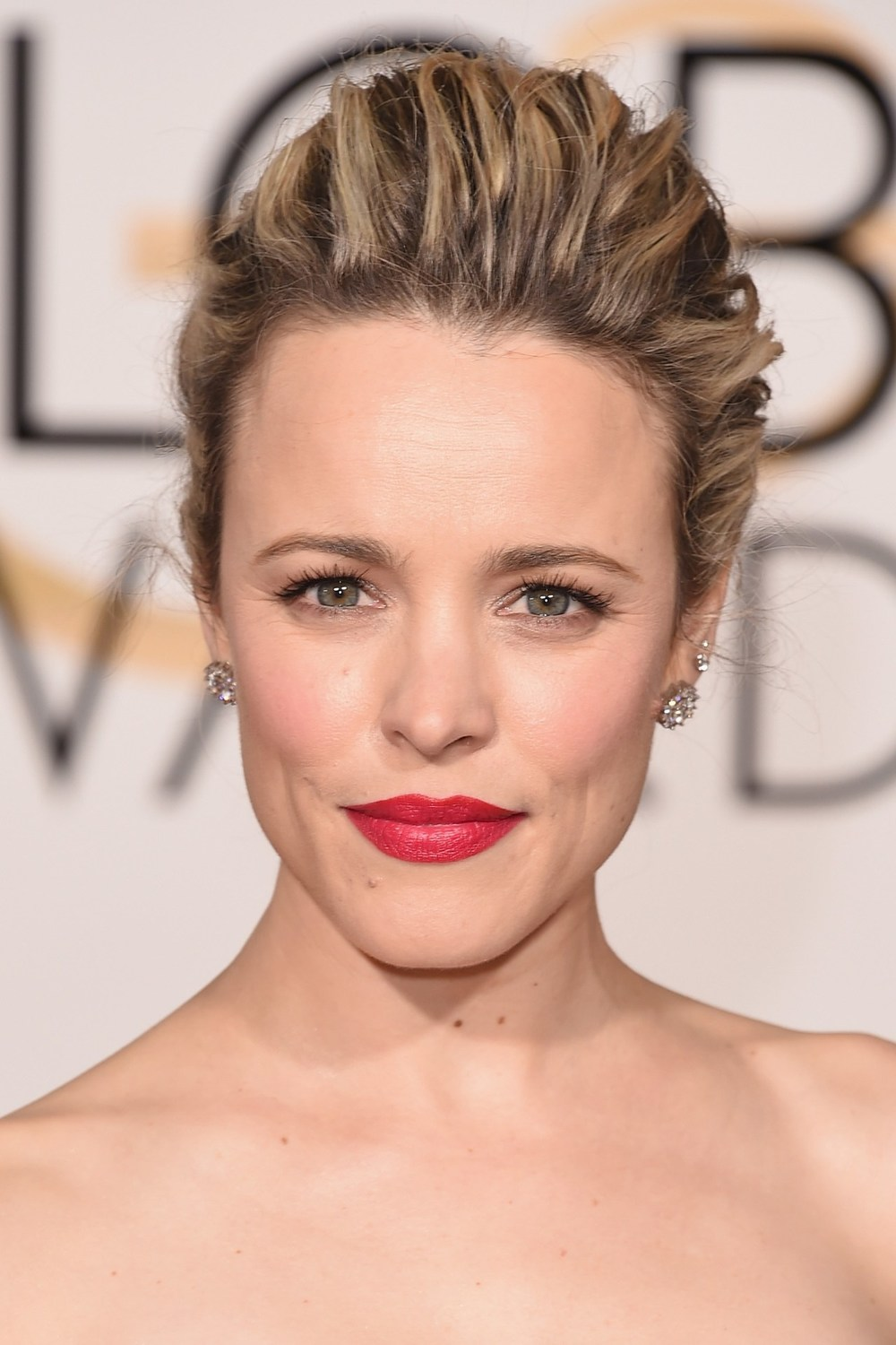 Rachel McAdams chose a swept-back up-do to emphasise her bold red lipstick.