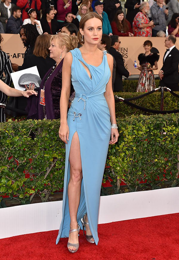 Brie Larson is feeling blue in Atelier Versace, with her hair in a minimal up do.