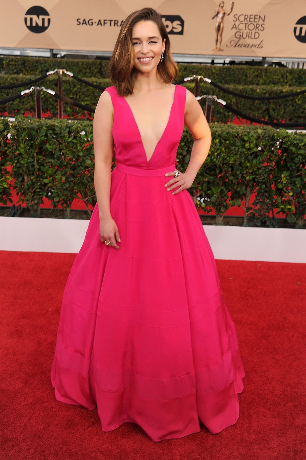 Emilia Clarke opted for a bright pink Dior gown.