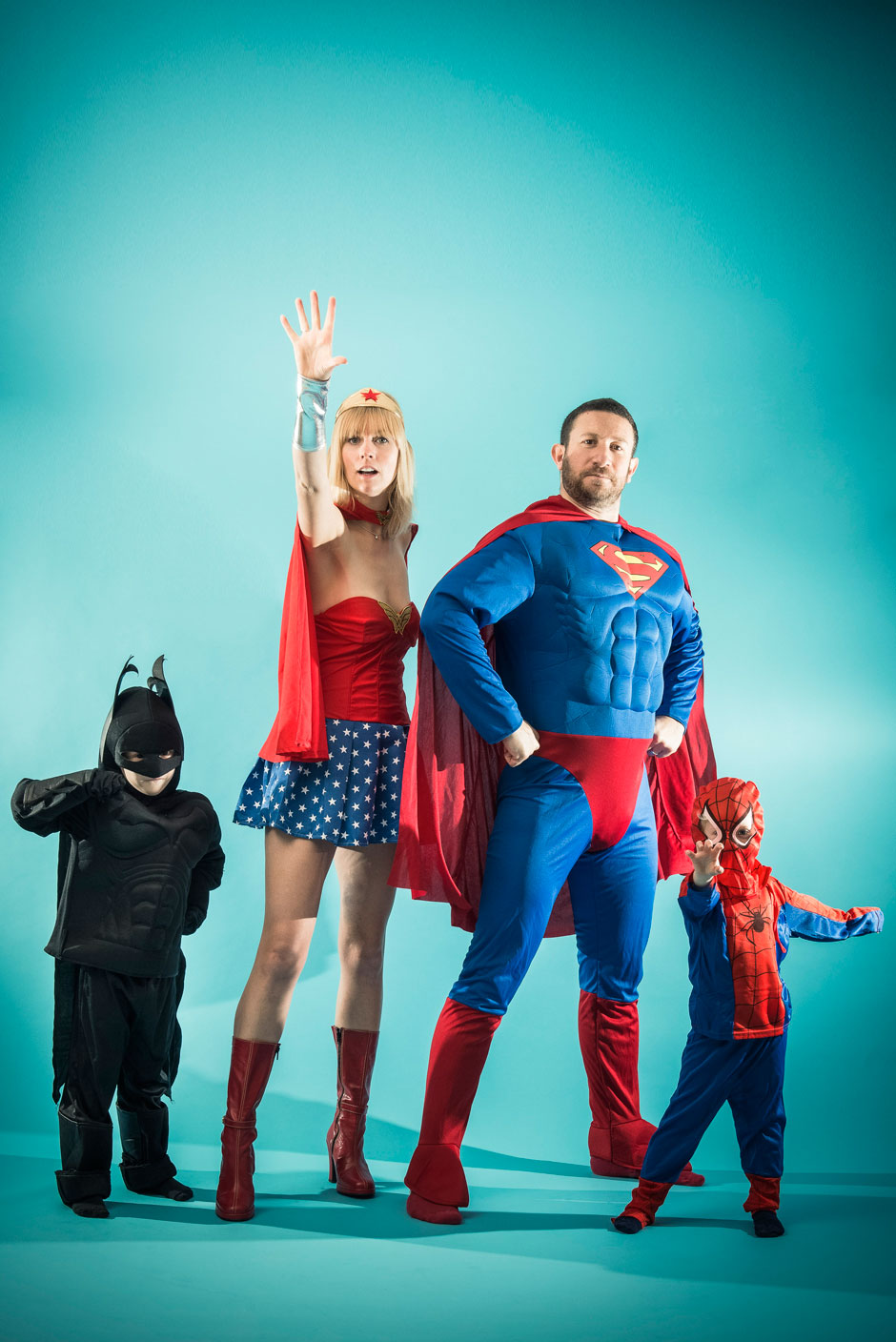family dressed up in superheroes costumes