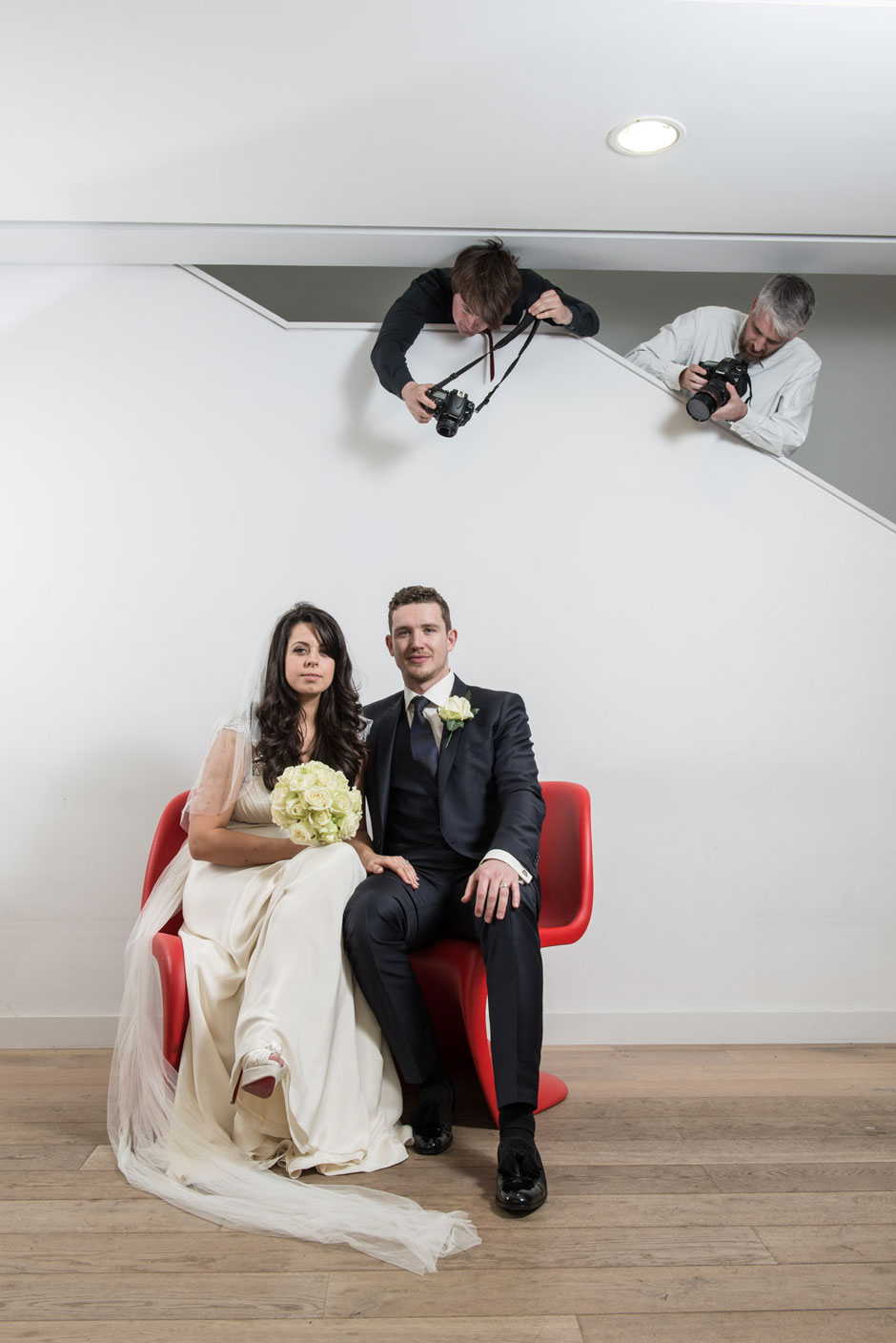 a bride and groom being shot by the photographer & videographer