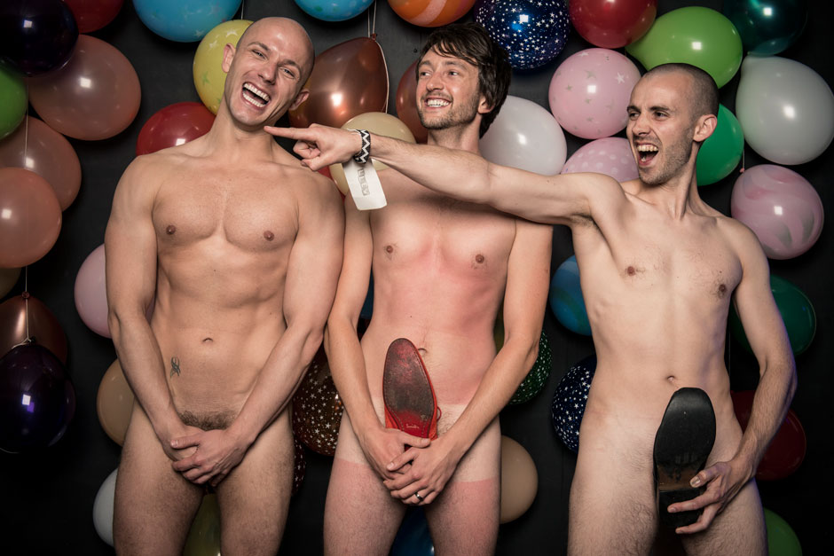 three naked men in a fun wedding photo booth