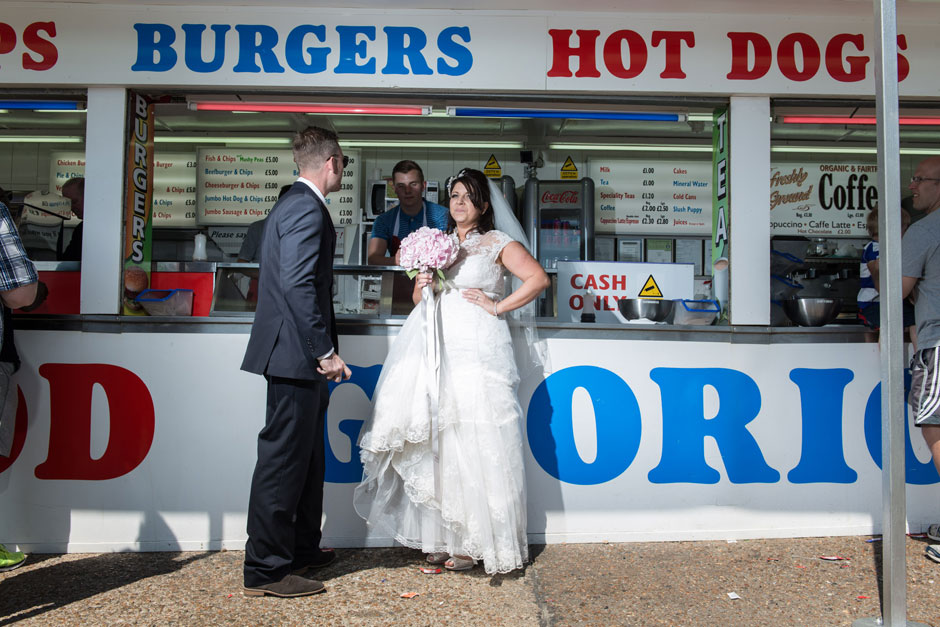 Bride & groom getting fish and chips on Brighton sea front & beach