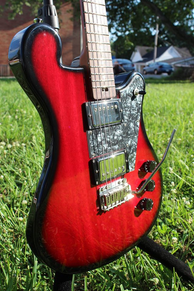 Custom Detroit in vintage red mahogany body See More!
