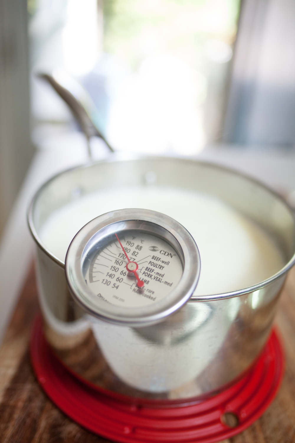 Once your stove temperature reaches 180 F, remove from heat, and let the temperature cool.  Once your milk reaches 108-112 degrees Fahrenheit, add in your leftover yogurt or yogurt culture starter and mix thoroughly.