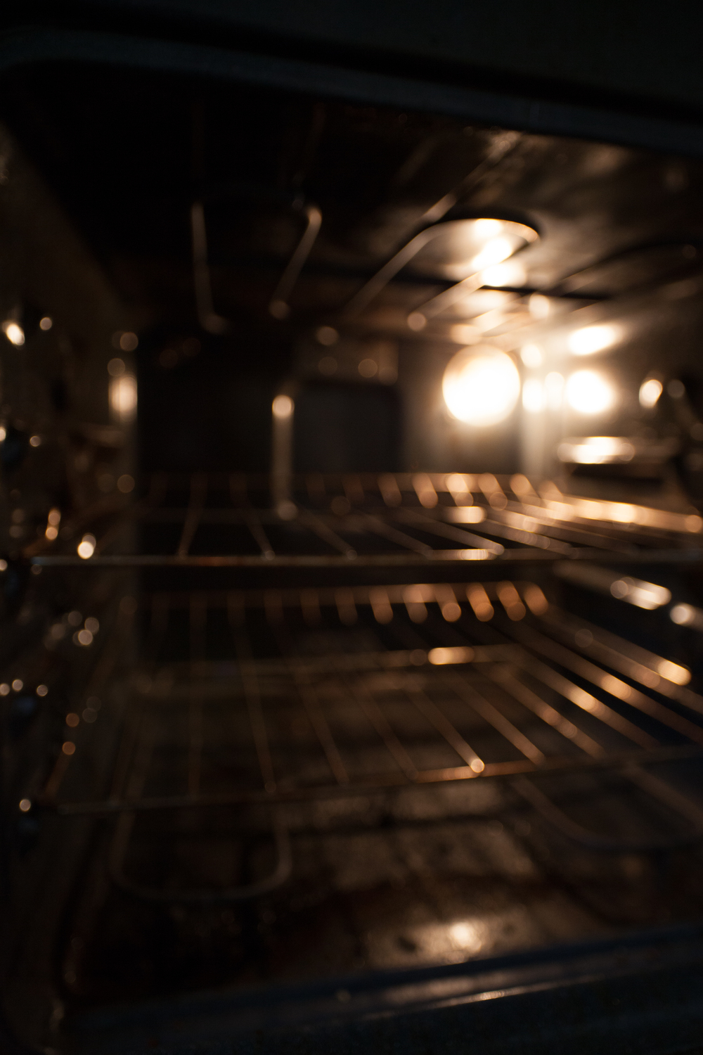 Keep that light on.  Turn on the oven light (without turning on the oven) to generate enough warmth to incubate your yogurt.