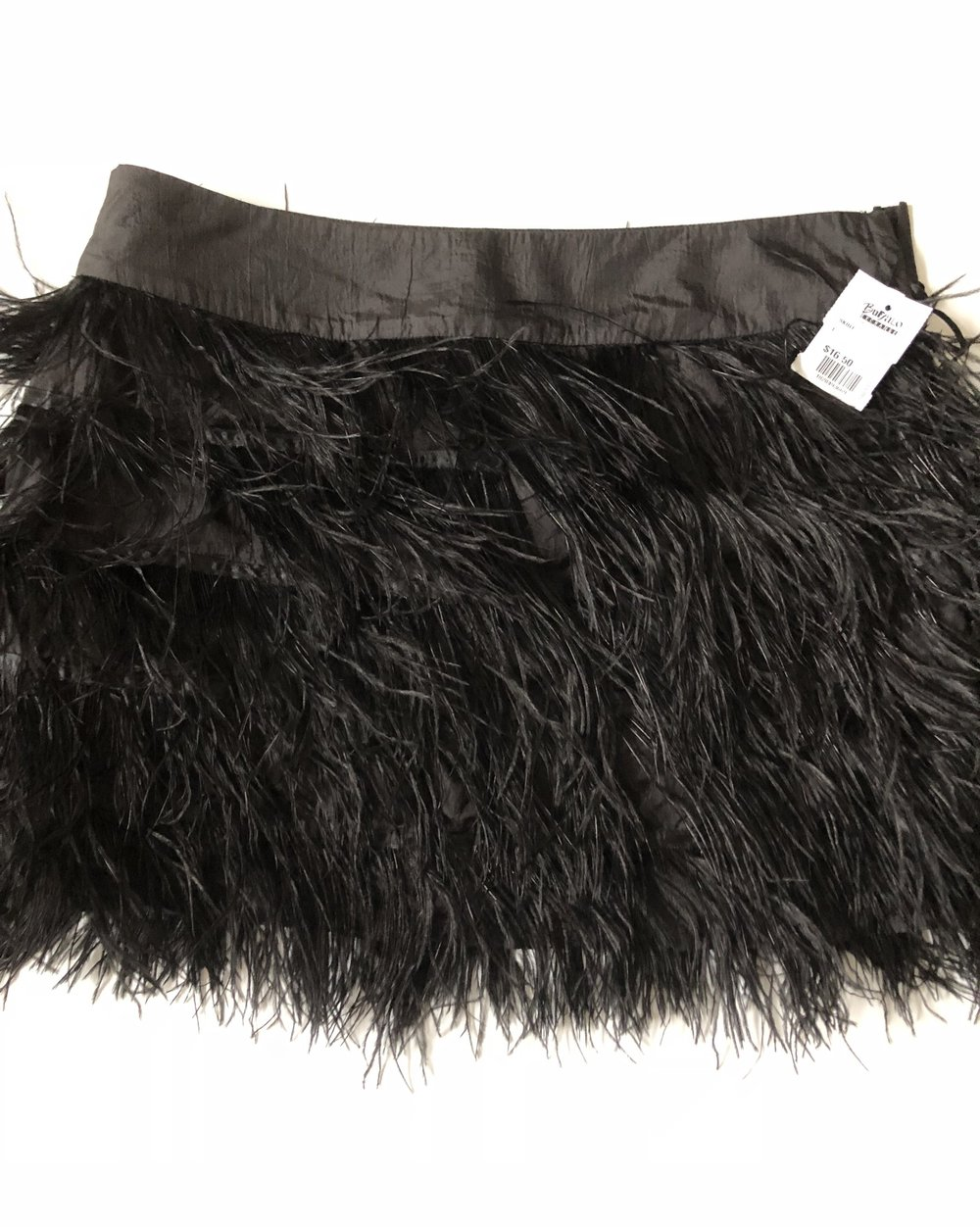 Fringe mini skirt $16.50, size large. It fits perfectly!