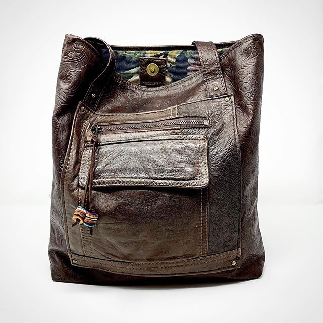 Salvaged leather jacket parts. An interesting, and still functional, pocket waiting to be restyled into a great tote. #restyled #repurposedleather #recycledfashion #recycledleather #handmadeleatherbags #indianaartisan #indianaartisanmarketplace #coatpocket
