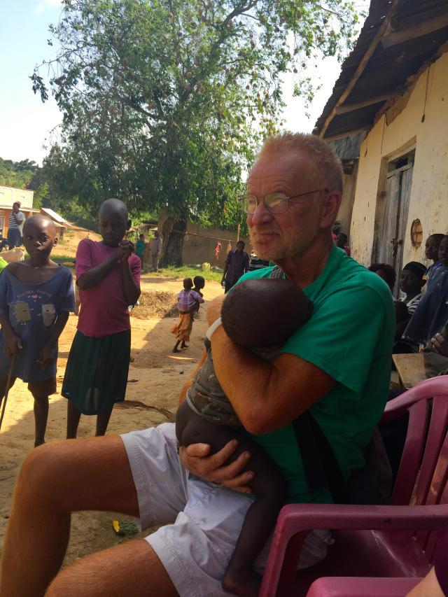 Miss  ion leader  Stephen Smith was in the village of Kiwaala for 15 minutes when this child walked up to him, crawled into his arms, and fell asleep. A retired educator, Stephen and his wife Mary have six children and have taken in 37 foster children over the years.