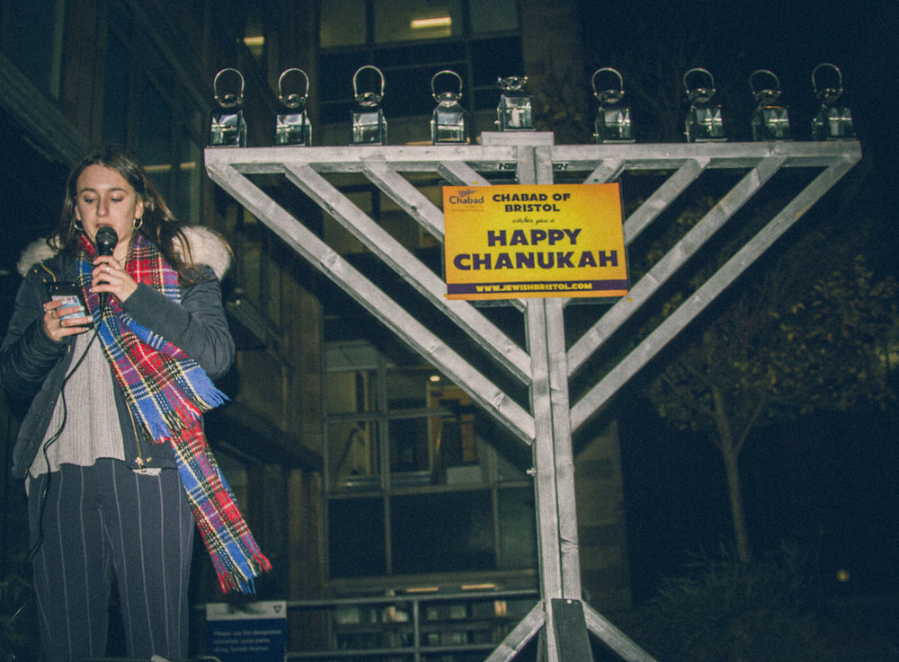 UJS Pres. Hannah Rose speaking at Grand Menorah Lighting on Campus