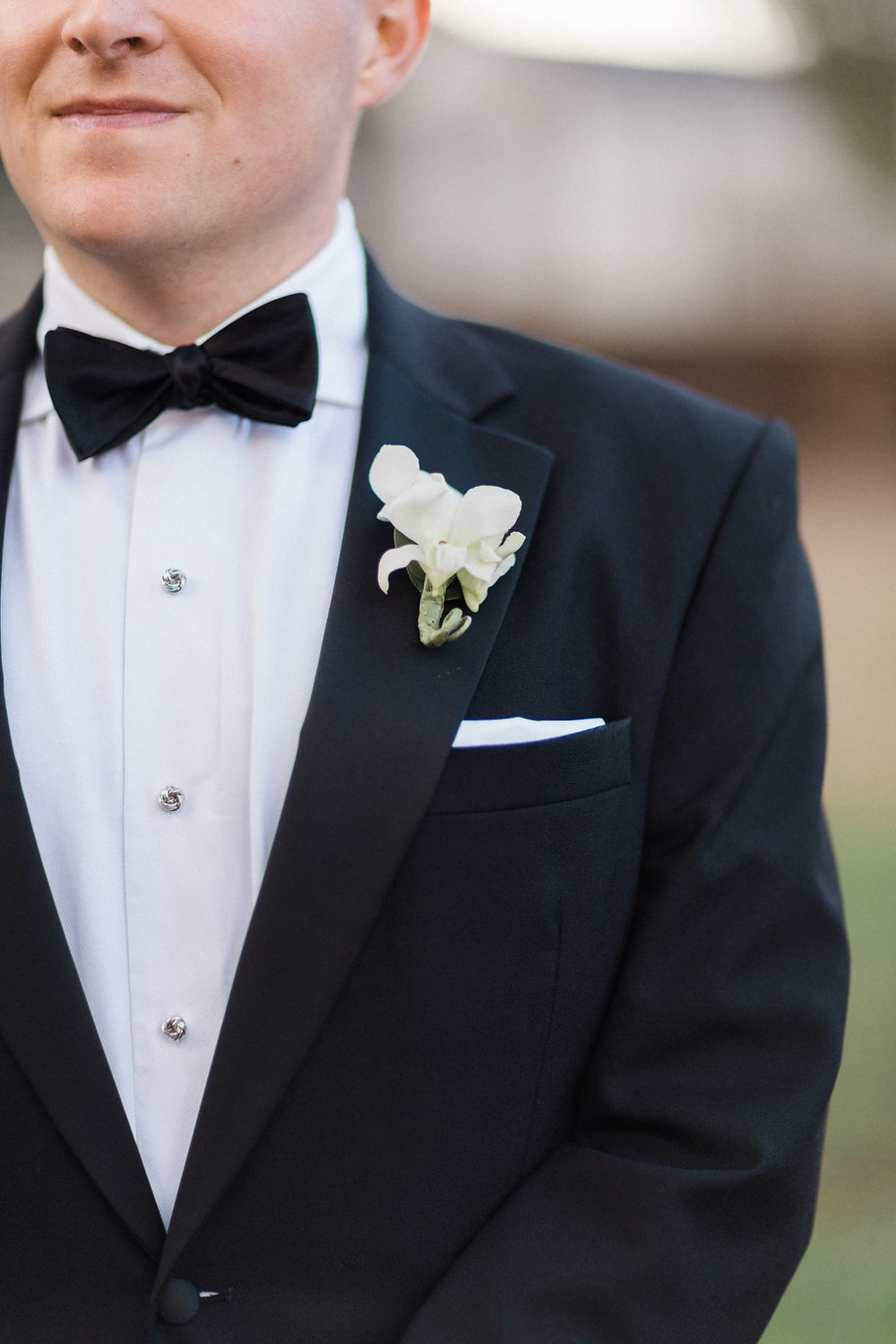 Groom orchid boutonniere