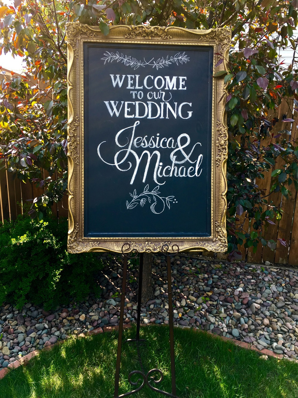 """Gold Gilded Chalk Sign (31"""" X 44"""") Rental includes easel.             $65/weekend  (includes custom chalk art)"""