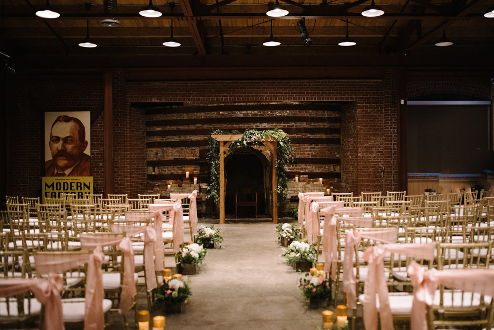 Gold chiavari chairs from   Grand Rental Station  make a beautiful statement at this navy and gold wedding.
