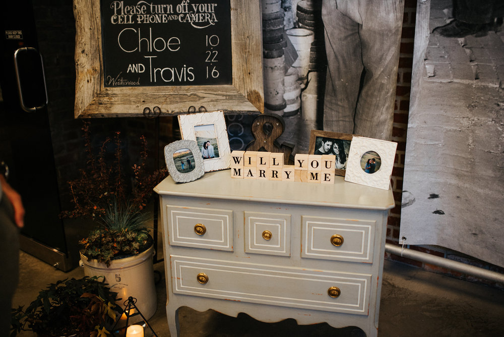 Such a cute addition at  the entrance to the ceremony...the same set up as Travis used to propose in a Lethbridge art gallery. We set up the dresser he had purchased and used the letter blocks and photo's he had assembled for his surprise proposal.
