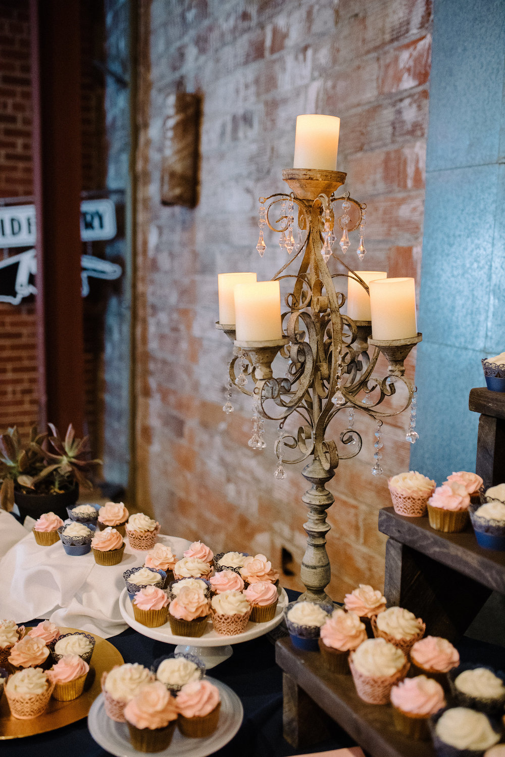 Sometimes it's the addition of one piece that adds dimension and glitz to a table (Weatherwood Events candlestick rental), although the aroma of these delicious cupcakes from   E nvision Cakes and Cupcakes was intoxicating!