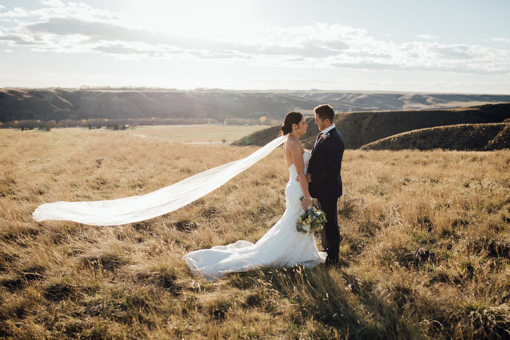 October is such a beautiful time of year for a wedding. The colors are vibrant and warm and if you hit a wonderful fall day like Chloe and Travis did the sun is perfect. This amazing shot was captured by  Schae Photography .