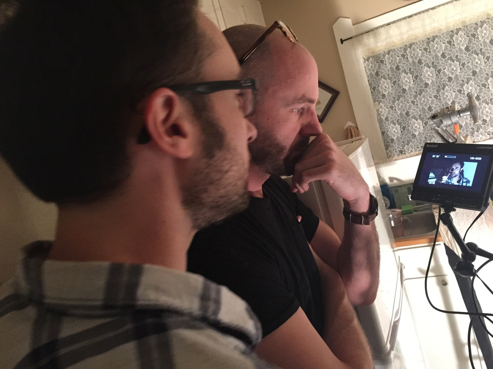 Director Matt Mercer acting in the lead role, reviews a critical shot with Cinematographer Patrick McGinley.