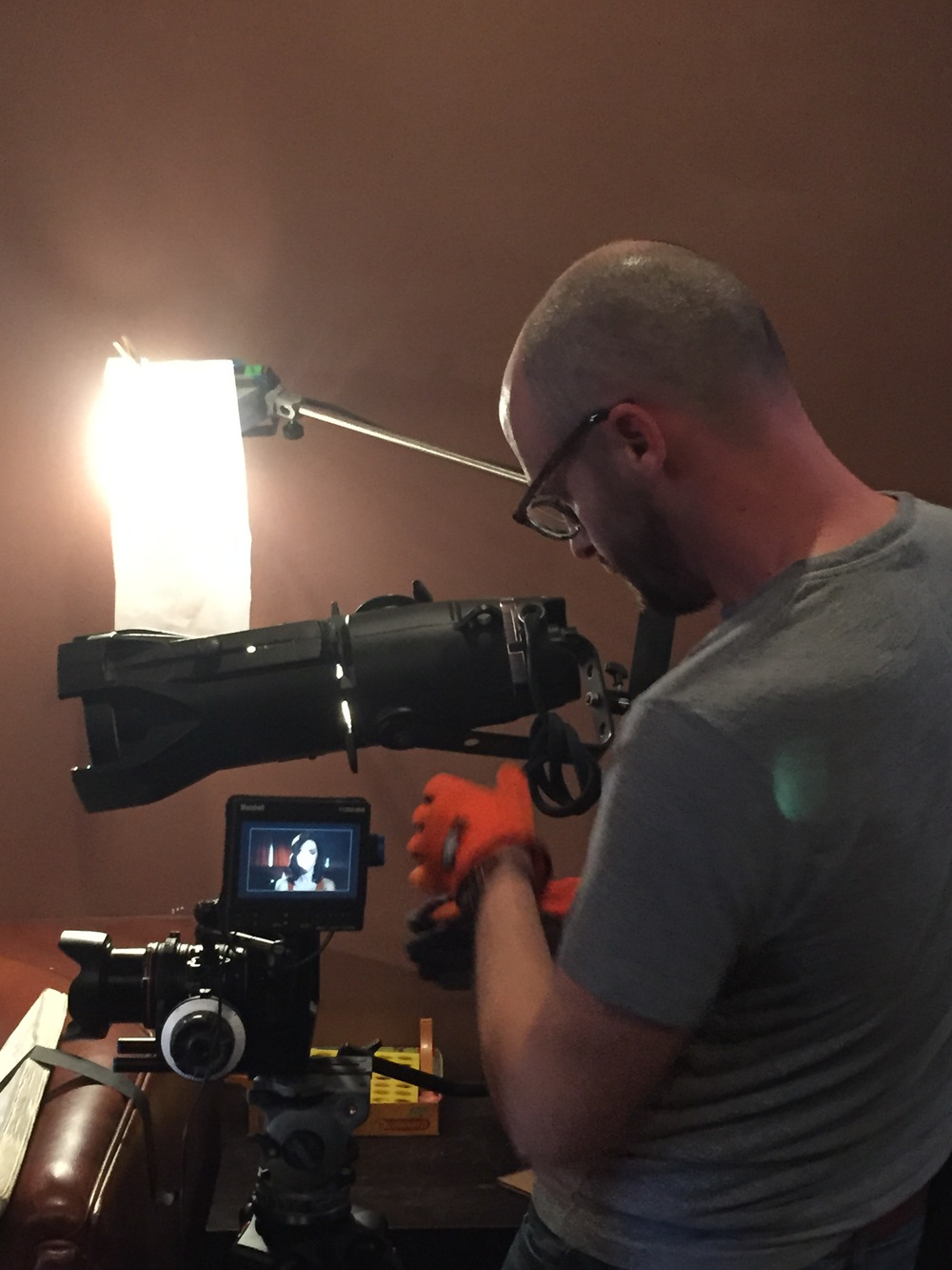 Cinematographer Patrick McGinley sets up the lighting for a crucial shot.