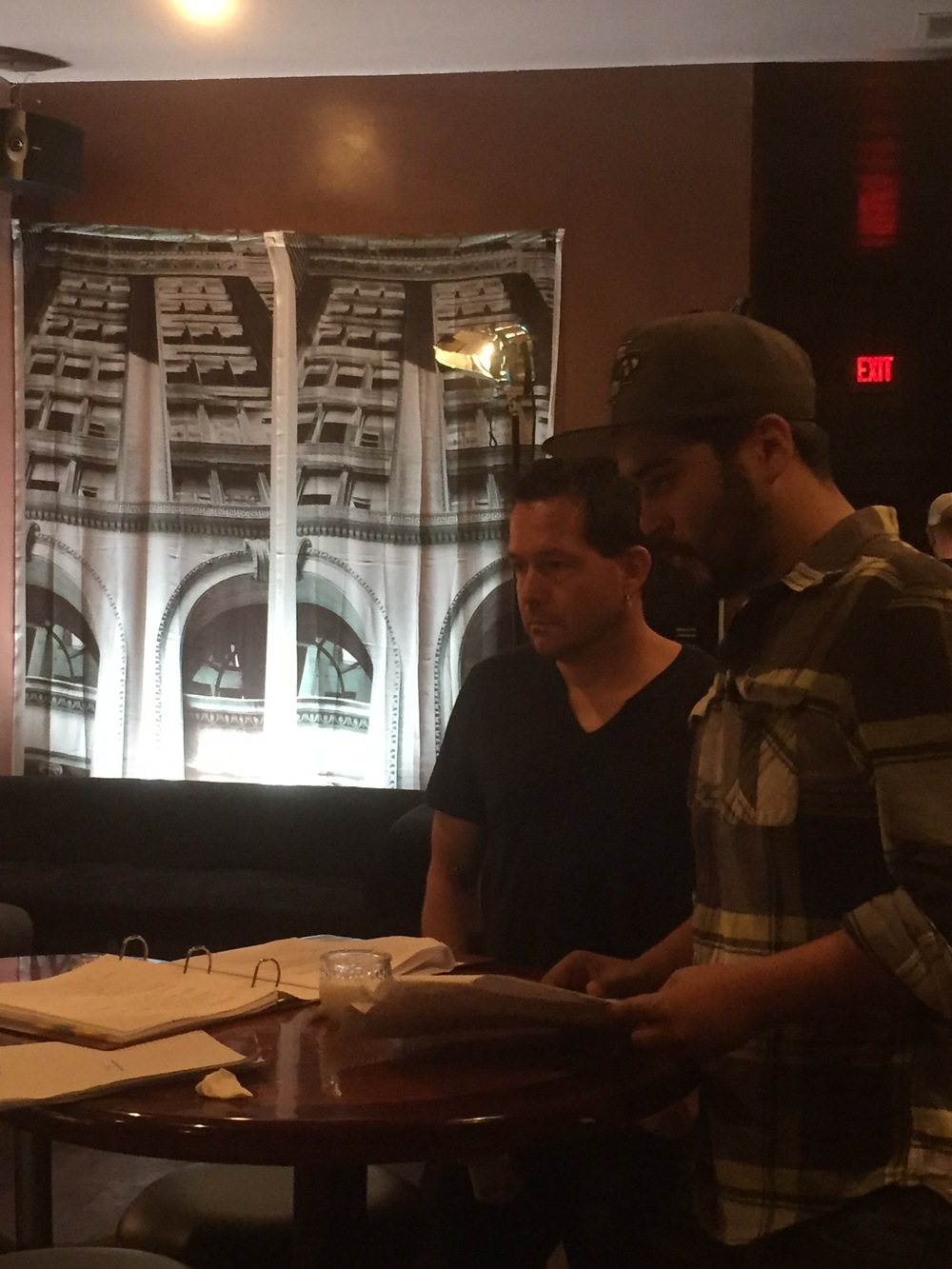 Kevin Sluder, Executive Producer and Writer, reviews the day's shot list with Gabe Arredondo, Co-Producer and Assistant Director