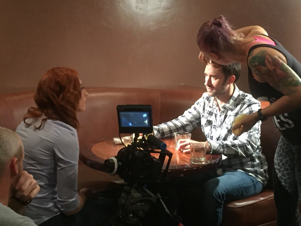 Key Make Up Artist Mariah Kraft preps Lead Actors, Matt Mercer and Najarra Townsend, for a bar scene.