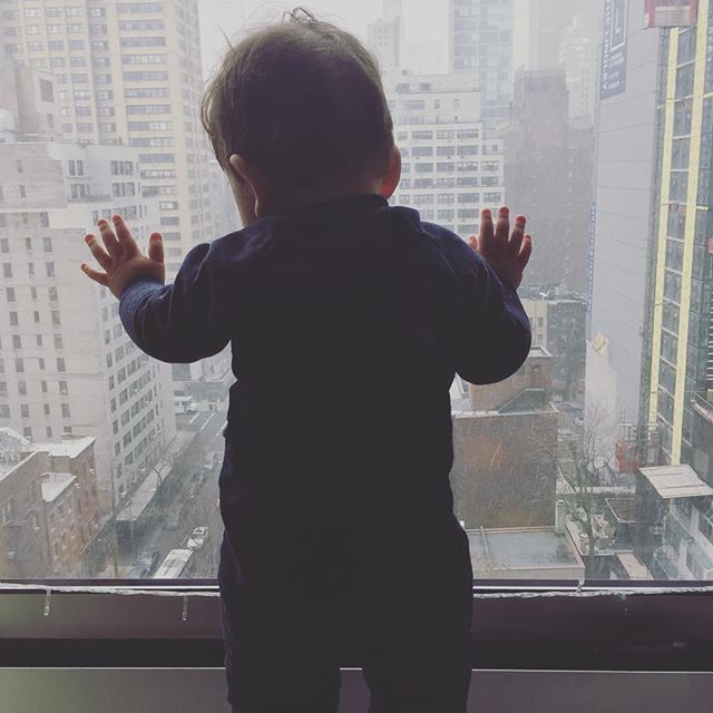 The holiday season just got real! Little dude is mesmerized watching the snow fall 😍#snowydays #nyckids #holidayweather #babyboy
