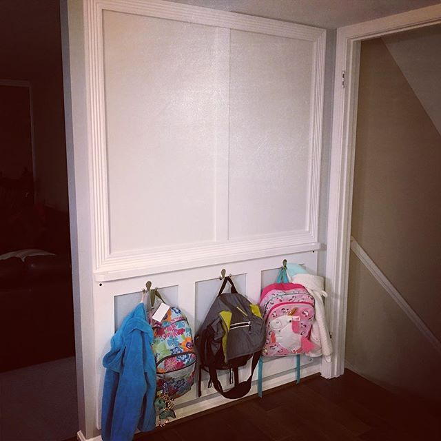 Not too shabby for a quick #project!  Two dry erase panels in the top framed out in #molding with a marker tray below and a few boxed hooks for backpacks below. Certainly not ground breaking, but it's nice to see the floor again!  #woodworking #shabbychic