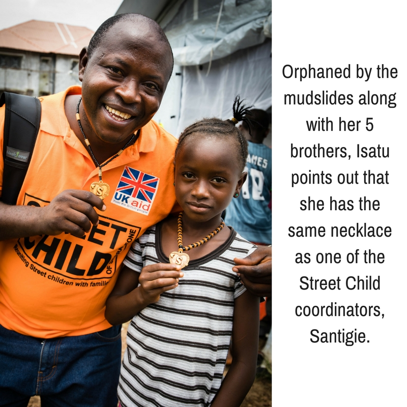 A girl orphaned by the Freetown mudslides pointed out that she has the same necklace as one of the Street Child coordinators, Santigie..jpg