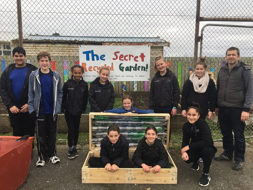 Patea students with their finished cold frame and new garden sign.