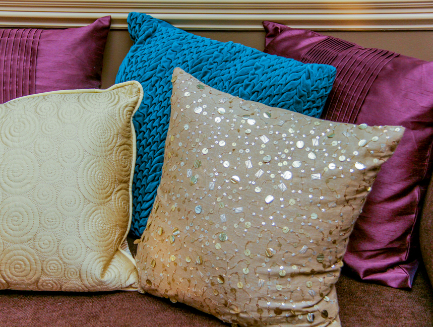 Display of accent pillows designed by sabine.