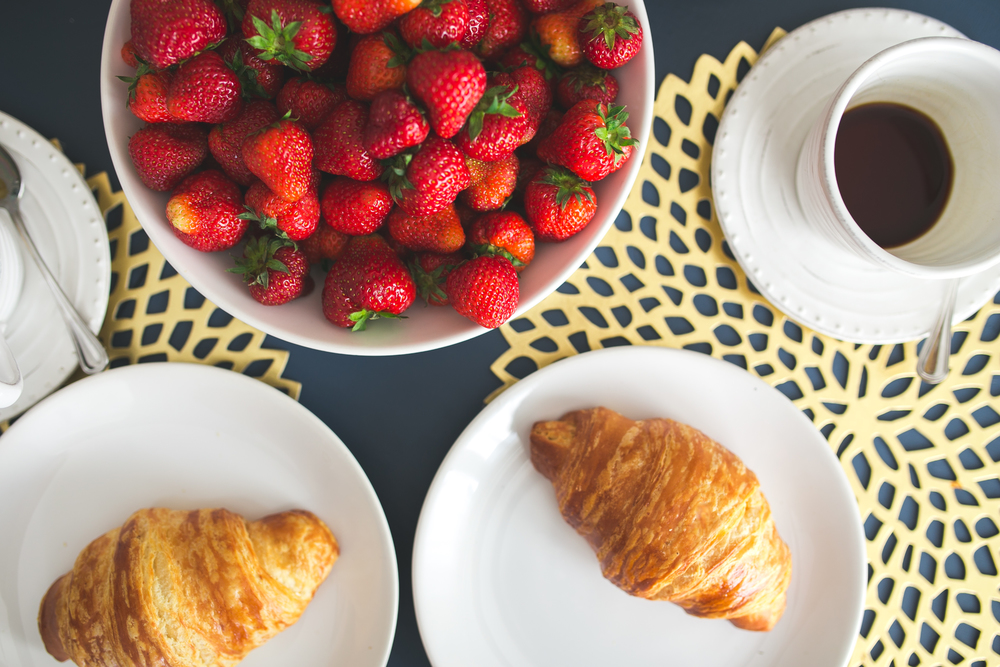breakfast with coffee, croissants & fresh strawberries
