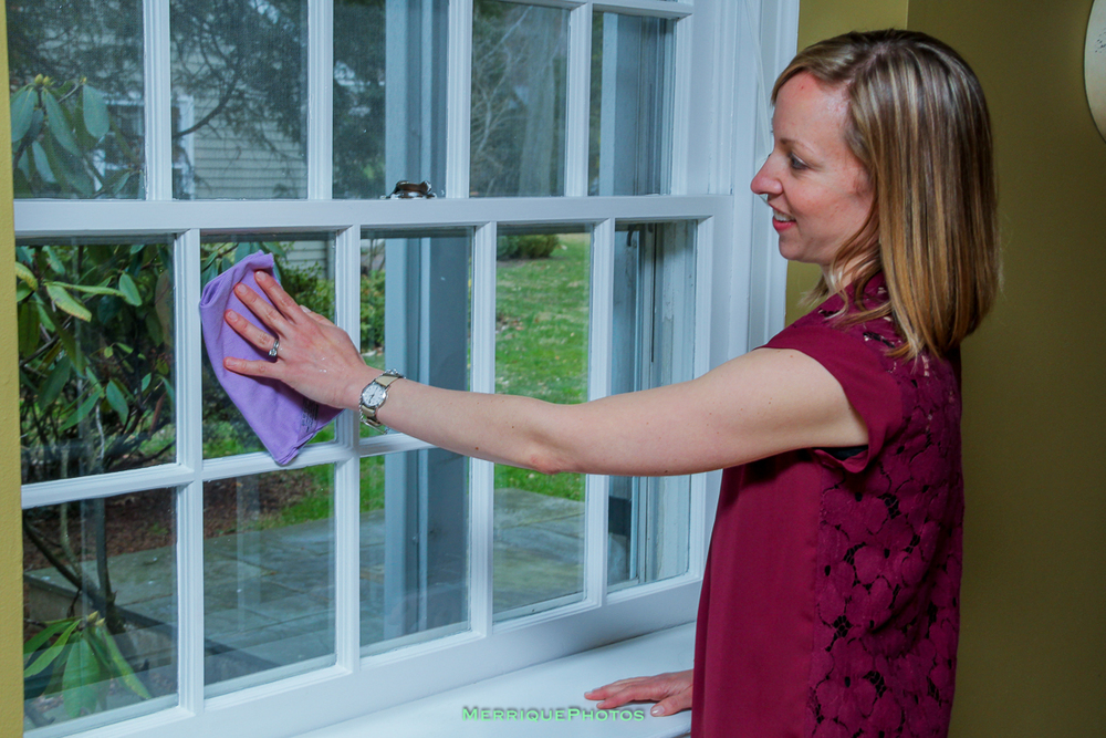 Tayler using her Norwex  Window Cloth