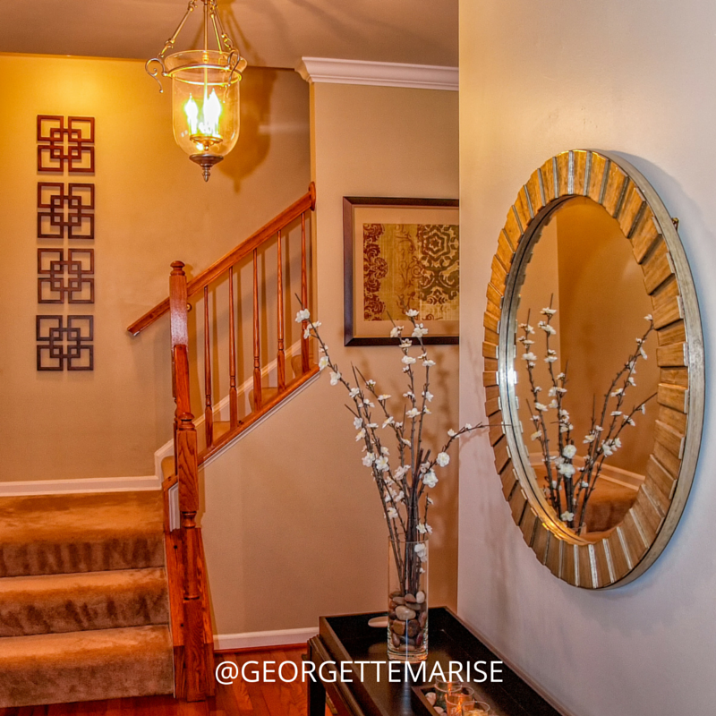 I used warm neutral tones and added geometric accents to this welcoming foyer.