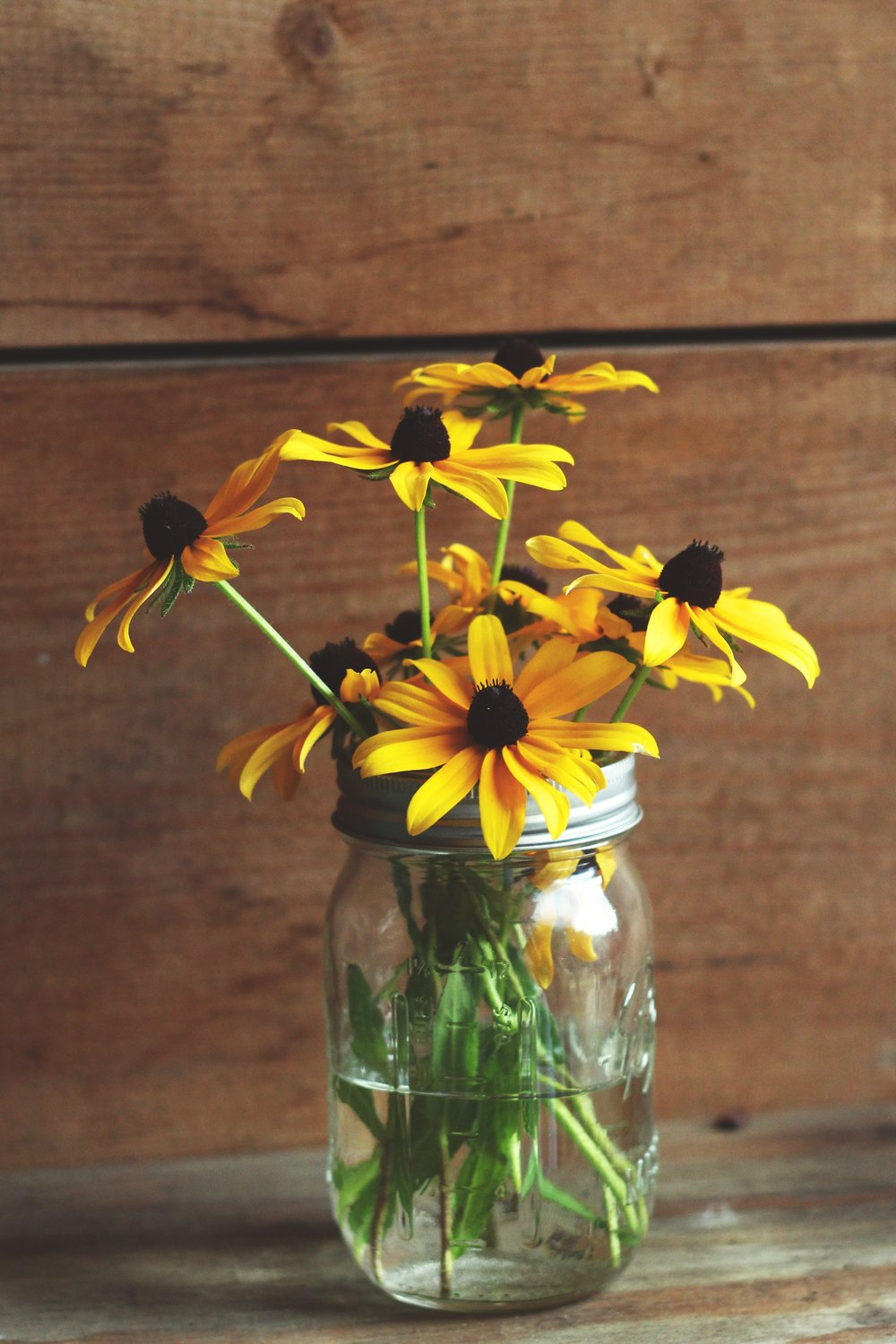 Some flowers placed in mason jars can add color and depth to your buffet stations.