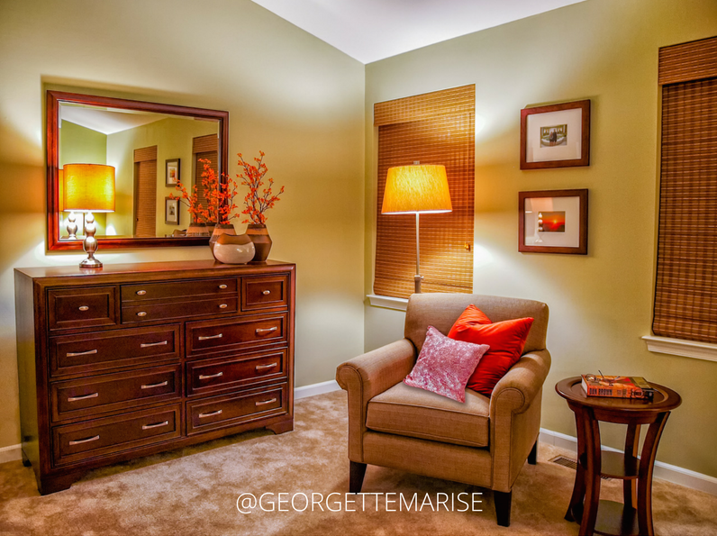 In this master bedroom, I used the chest of drawers/dresser and an accent chair to create a functional sitting area.