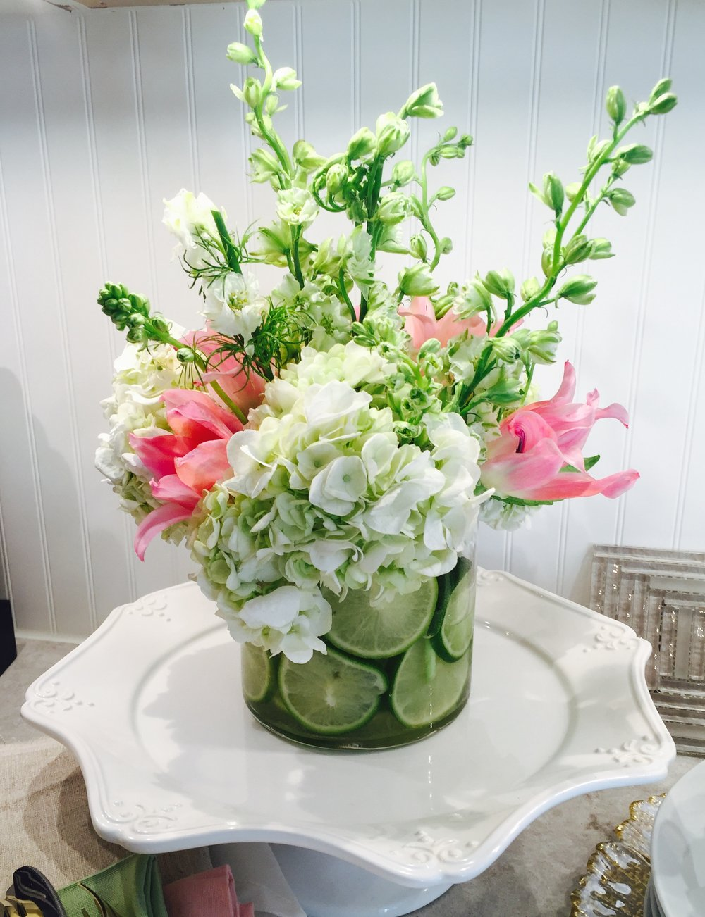 Spring Floral Centerpiece with fresh cut limes designed by Georgette Marise Interiors.