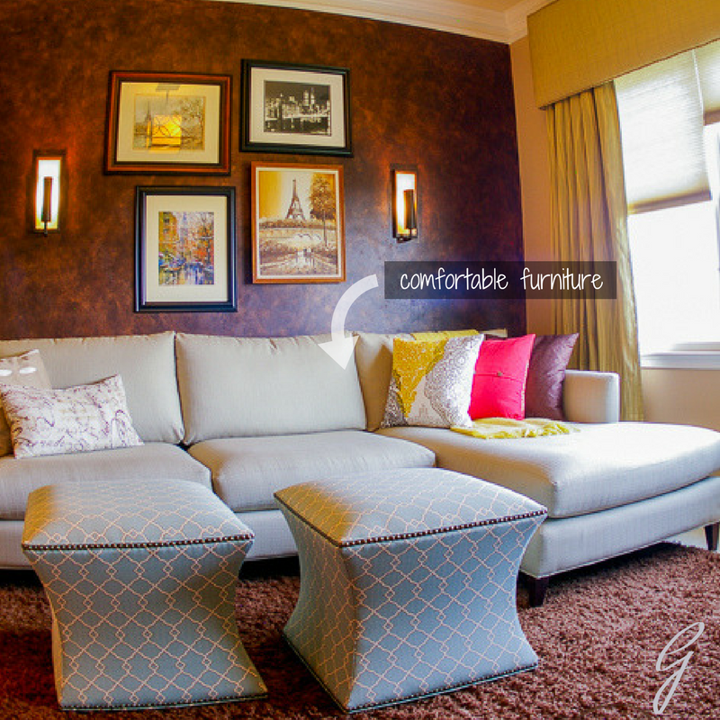 This sitting room has a comfortable sofa with an attached chaise for lounging after a long day.