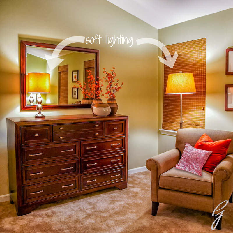I used a table lamp on the dresser and a floor lamp near the chair as forms of soft accent lighting.