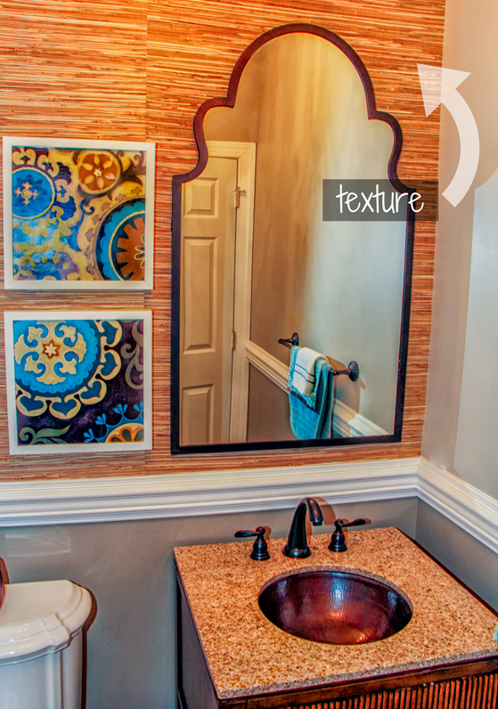 This powder room is designed with a textured grasscloth wallpaper and a hammered copper bowl sink.