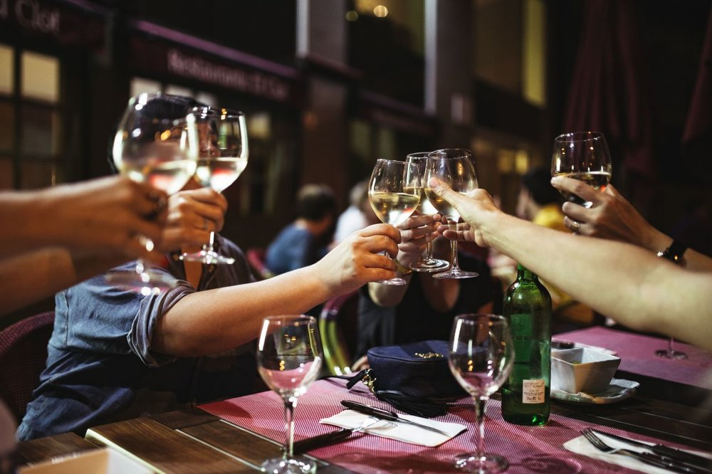 kaboompics_People holding glasses of white wine making a toast.jpg
