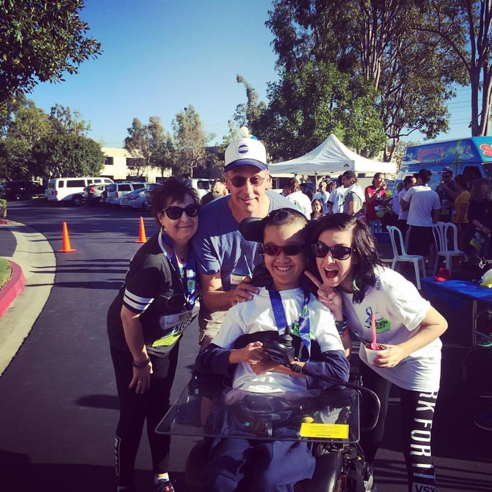 Christina's Mother, Christina's Father, Ben, and Christina at the 2nd Annual Global Genes Denim Dash