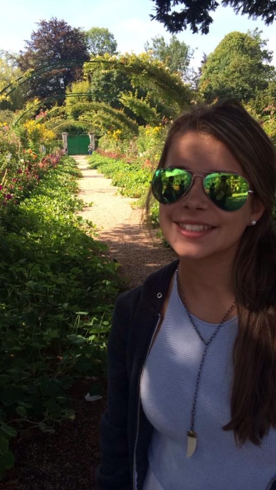 Grace   in her F  ranky's horn necklace at Monet's garden, Giverny!   (Courtesy of Grace Jarrett).