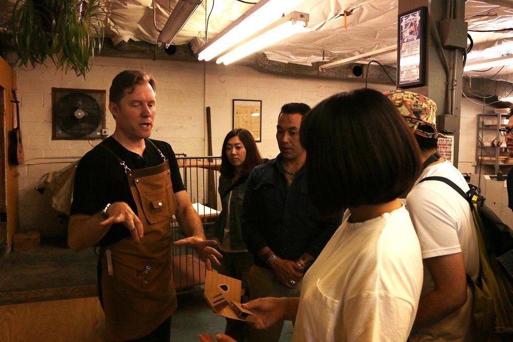 Owner of Stumptown Printers, Eric Bagdonas, teaching the team about letterpress printing.