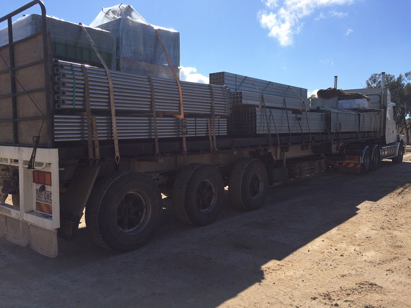 A truck load of panels and gates arriving on site.