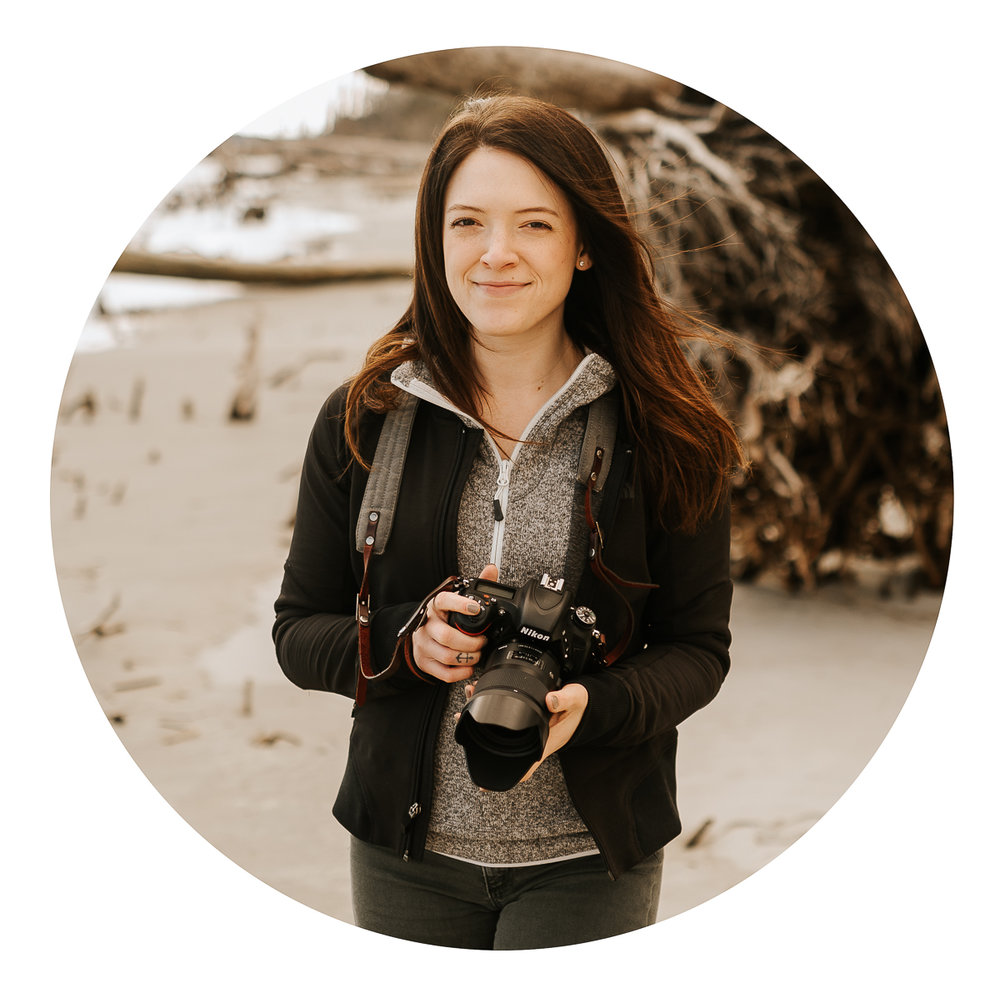 Media, PA based photographer holding camera in hands on beach
