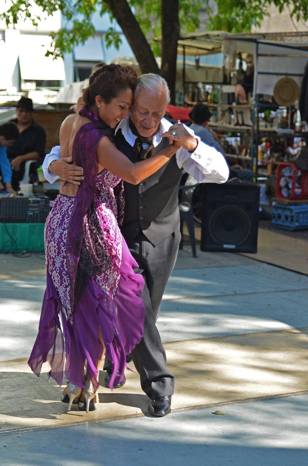A couple dancing tango at the San Telmo weekend market.